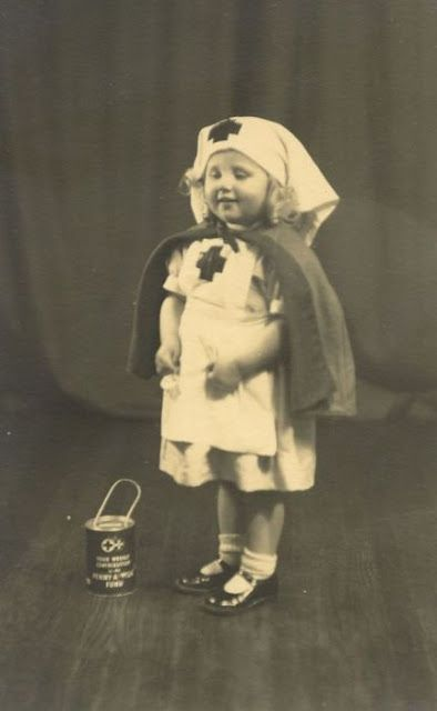 Vintage nursing photos. *This would be an adorable Halloween costume!! We have to do it if we ever have a little girl. Hubby and I could take her TorT'ing wearing our [modern] nursing scrubs!!