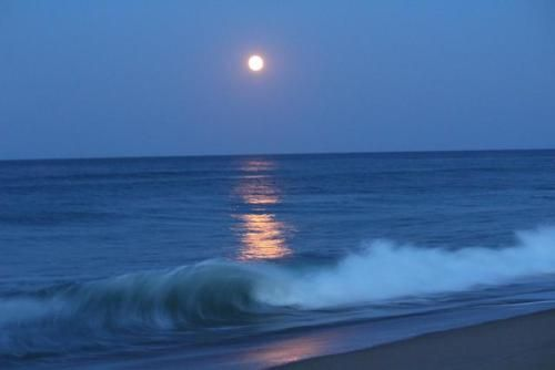 Full strawberry moon rising over the surf in Nags Head North...