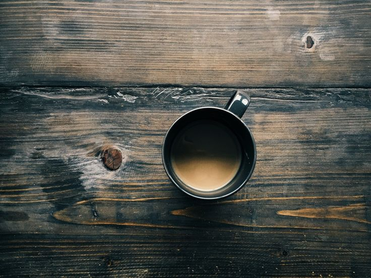 Aerial view of coffee cup on wooden table Photo - Visual Hunt
