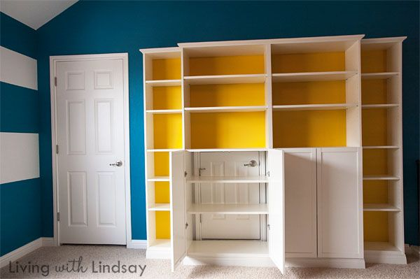 "How to Use a ""Built-In"" Billy Bookcase to Hide an Eyesore via MakelyHome.com. I'd love to have something like this on the western wall of the living room."