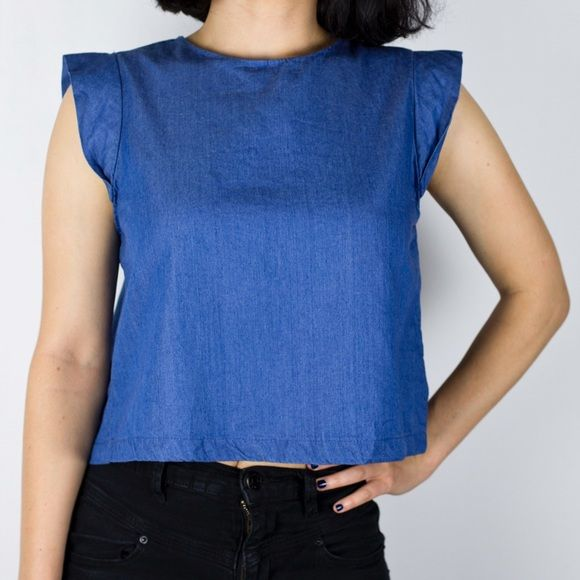 ⚡️WEEKEND SALE⚡️Zara Trafaluc Denim Crop Top BNWOT! My favorite part of this shirt is the cute tucked back. The shirt is wonderful for dressing up or down. Price has been lowered from 38 and is now firm. Zara Tops Crop Tops