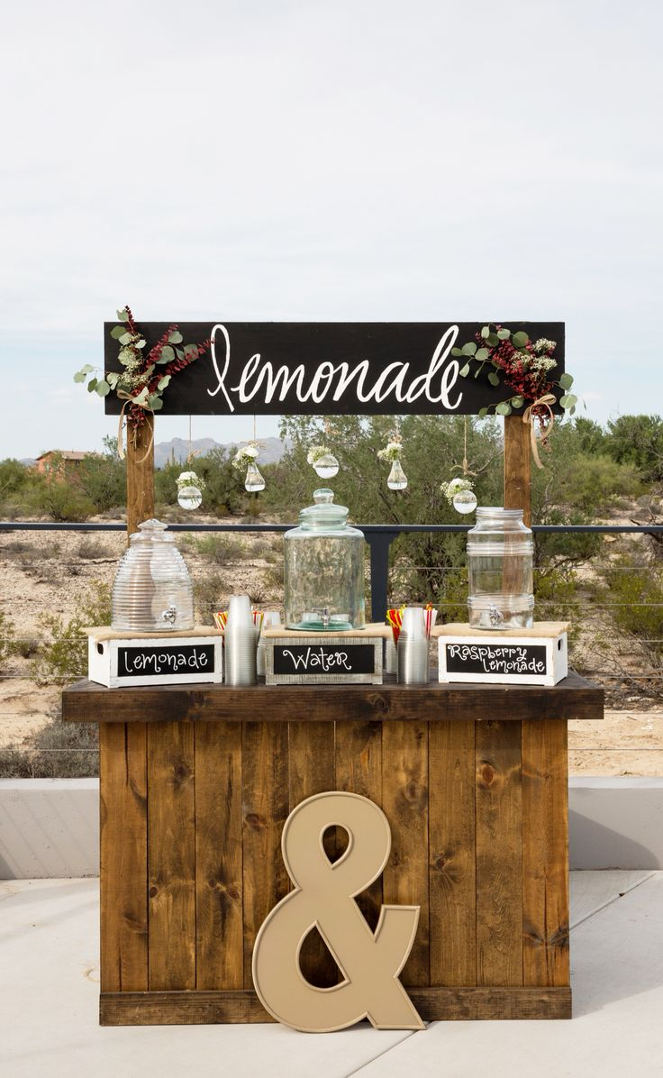 Wedding Lemonade stand. DIY. Used the Oregon work bench plans and added slats around front and sides.