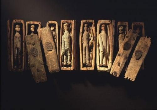 Tiny Coffins of Arthurs Seat  In 1836, five young boys, hunting for rabbits on Arthurs Seat in Edinburgh, found 17 minature coffins hidden inside a cave.  Each coffin, only 4 inches in length, contained a little wooden figure, expertly carved with handmade clothing and little painted boots.: Rabbit, Arthur Seats, Wooden Figures, Doll, Miniatures Coffin, Young Boys, Caves, Black Boots, Arthurseat