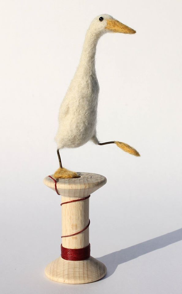 Felted white duck on a spool...