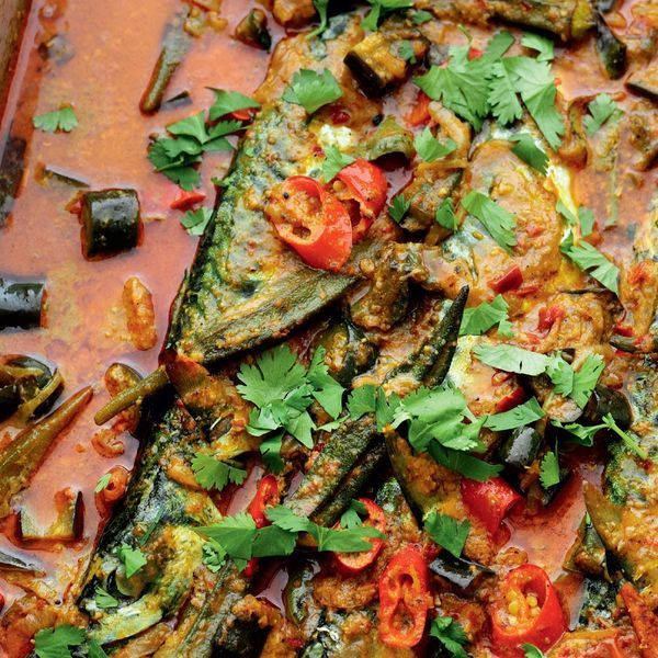 A Malaysian fish curry recipe from Rick Stein's Far Eastern Odyssey. Showcasing mackerel, alongside a mix of okra, aubergine, tomatoes and coriander leaves.
