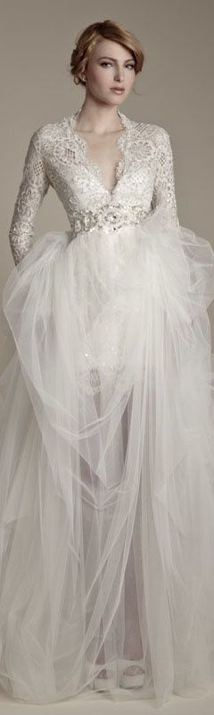 Elegant perfection for a Winter wedding.  Strapless gowns look ridiculous in the Winter.