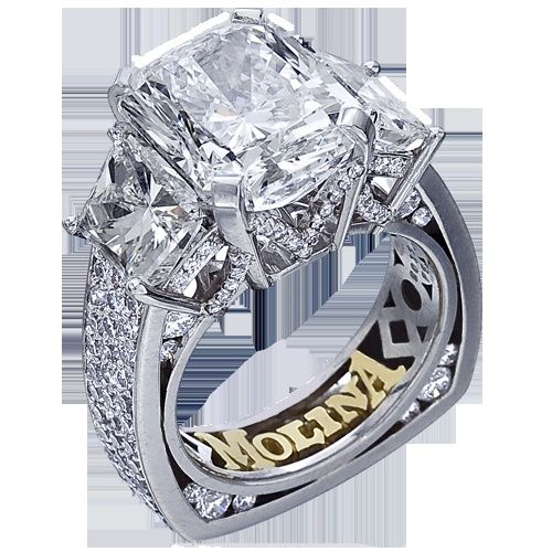 212 Platinum three stone engagement ring containing one 6.22 caratradiant diamond two trapezoid?side stones weighing 2.68 carats and 1.59carats of round brilliant diamonds..