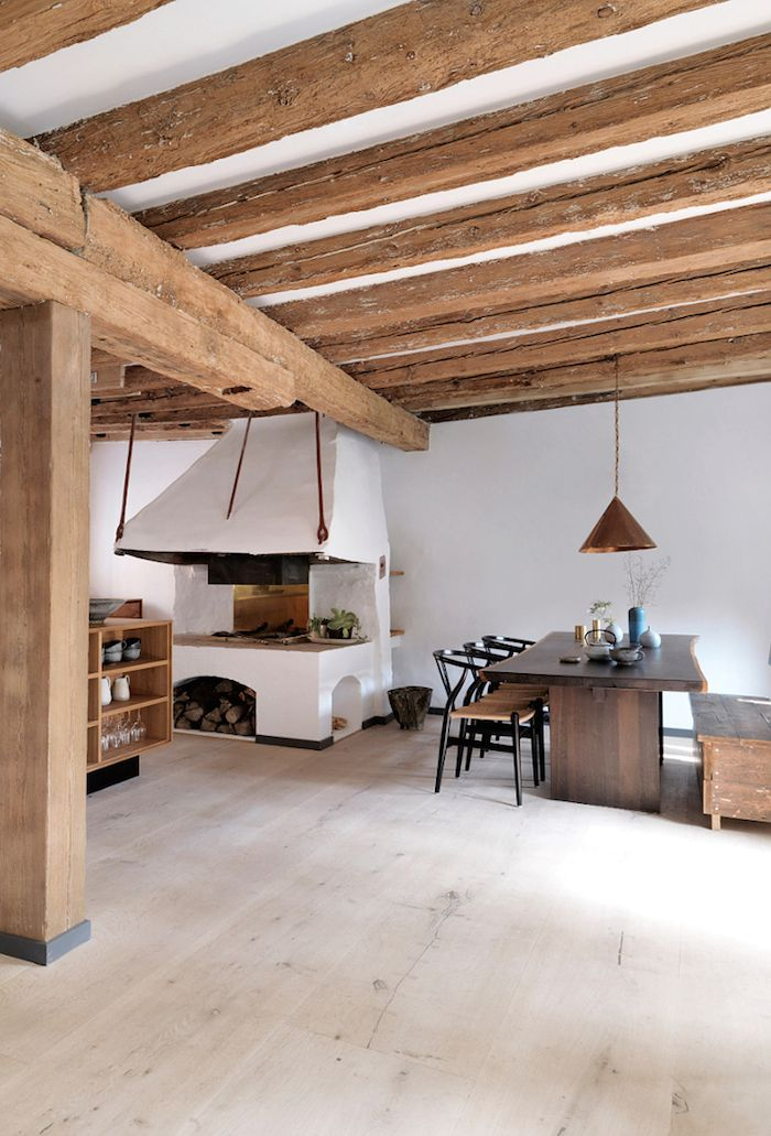 A beautiful kitchen design by Gardehvalsoe, using Dinesen HeartOak, for both the kitchen cabinets and the flooring, the kitchen sink is burnished brass. Love the exposed beams and old cooking range in this listed property in Copenhagen, belonging to world renowned chef René Redzepi | via Gardehvalsoe & Dinesen ~ debra Dust Jacket on Bloglovin'