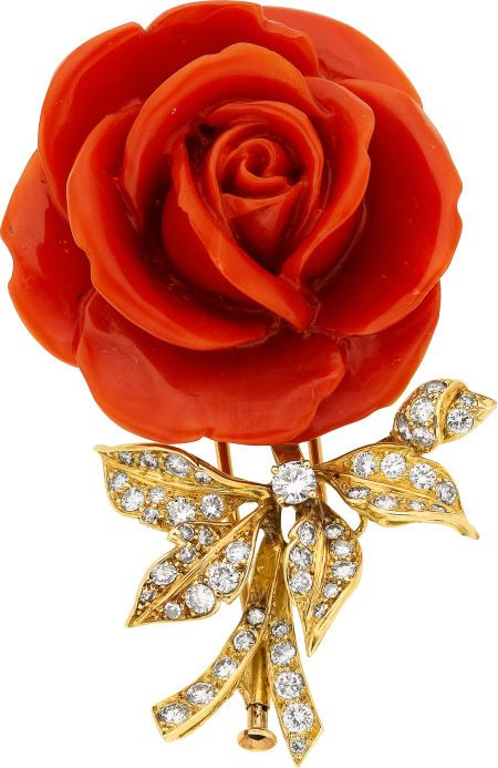 Coral, Diamond, Gold Brooch, Boucheron, French  The brooch features a carved coral rose, enhanced by full-cut diamonds weighing a total of approximately 1.50 carats, set in 18k gold, marked Boucheron.