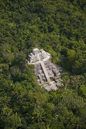 "The Mayan ruins of Lamanai once belonged to a sizable Mayan city in the Orange Walk District of Belize. ""Lamanai"" comes from the Maya term for ""submerged crocodile"", a nod to the toothy reptiles wh..."