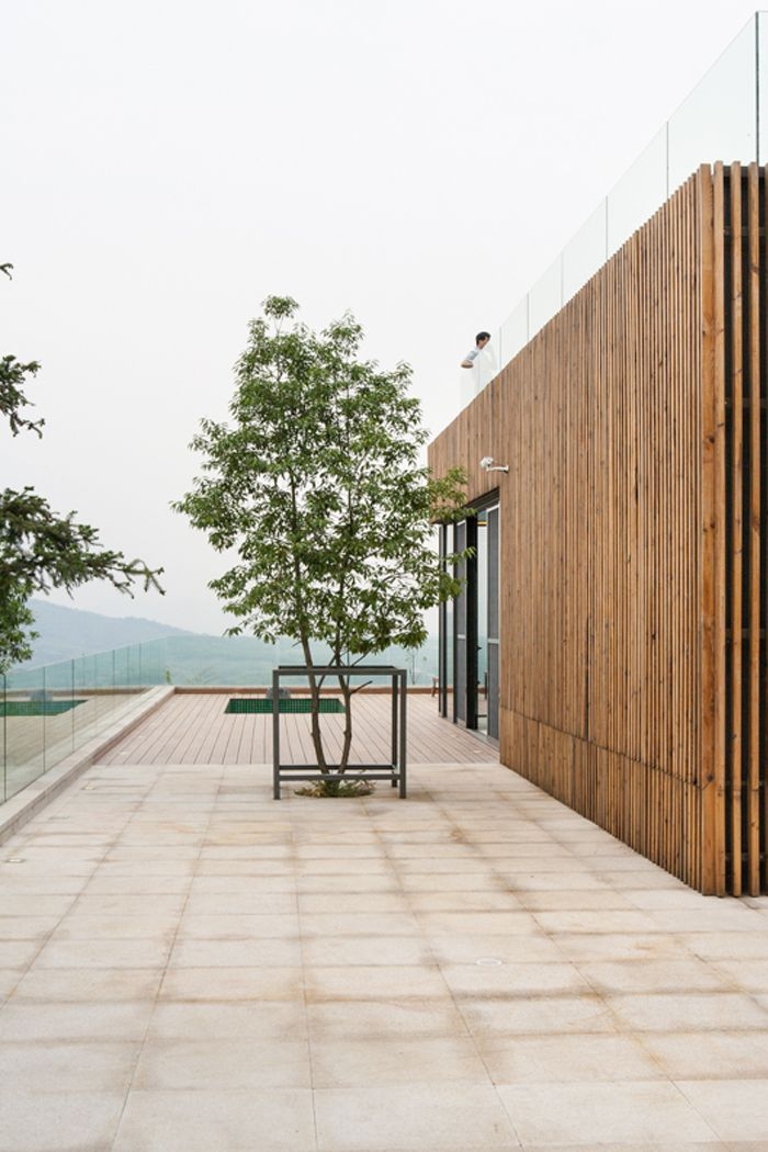 Saved tree at the terrace, Spa-Clubhouse, Garden Valley - Mei Jie Mountain Hotspring resort in Liyang, China. by AchterboschZantman architecten