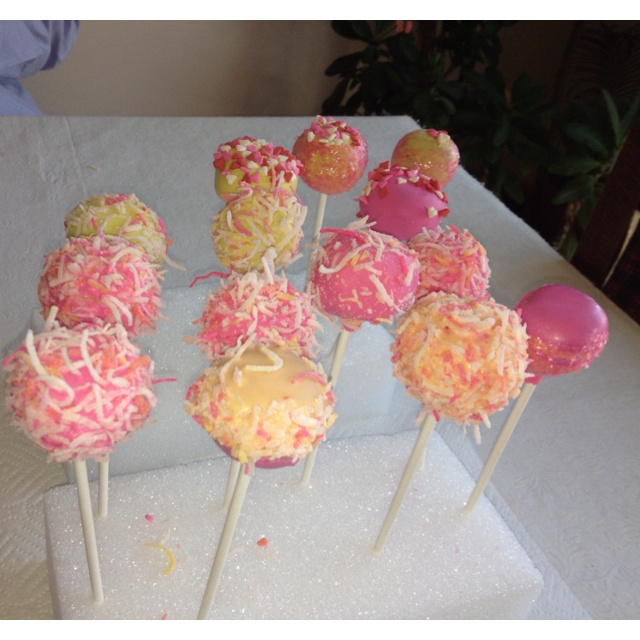 Yellow and pink baby shower cake pops with coconut topping! Mmm.