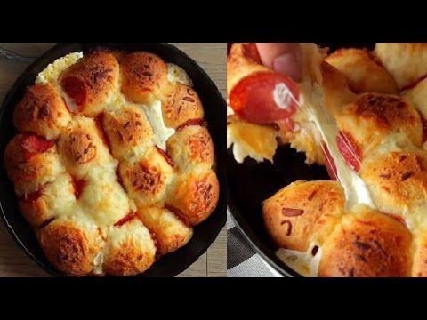 BuzzFeed Food - Pull Apart Pizza Bread RECIPE: Take 1 biscuit dough and slice in half Flatten into a circle Fill with a slice of pepperoni, a cube of mozzare...