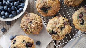 Blueberry muffins with berries and cooling rack. Please see my portfolio for other food and drink images.