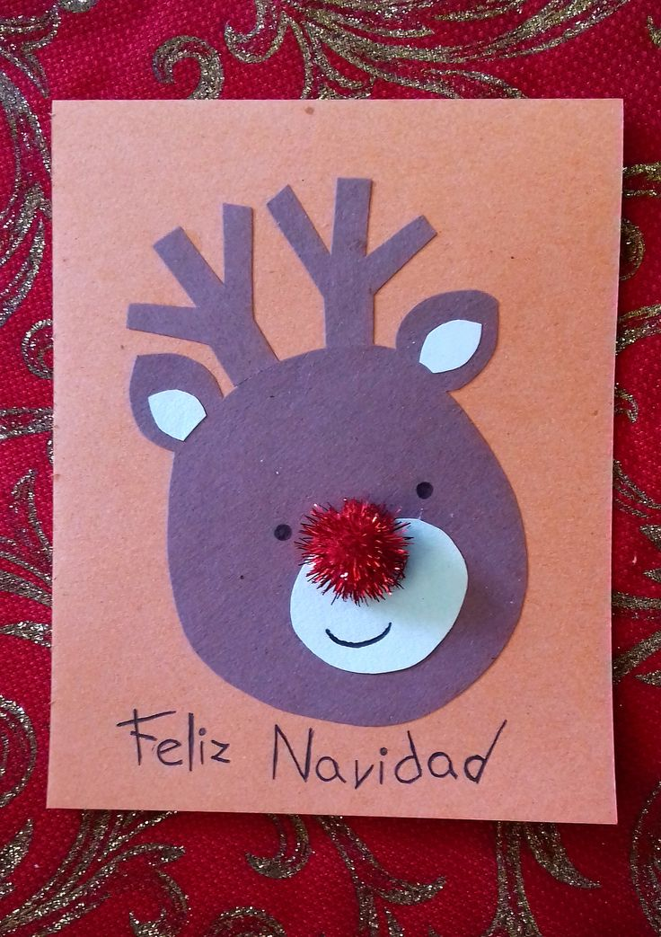 Tarjeta de RENO hecha con papel de cartulina de color chocolate, papel cartulina de color blanco, bolilla roja con brillo y papel cartulina de color anaranjado. ¡Pequeño renito sencillo de hacer!