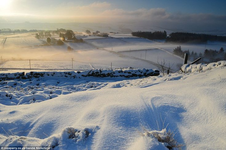 This snowy scene of the sun rising over the Holme Valley, West Yorkshire was taken from Wolfstone Heights, near the village of Upperthong 12-29-14