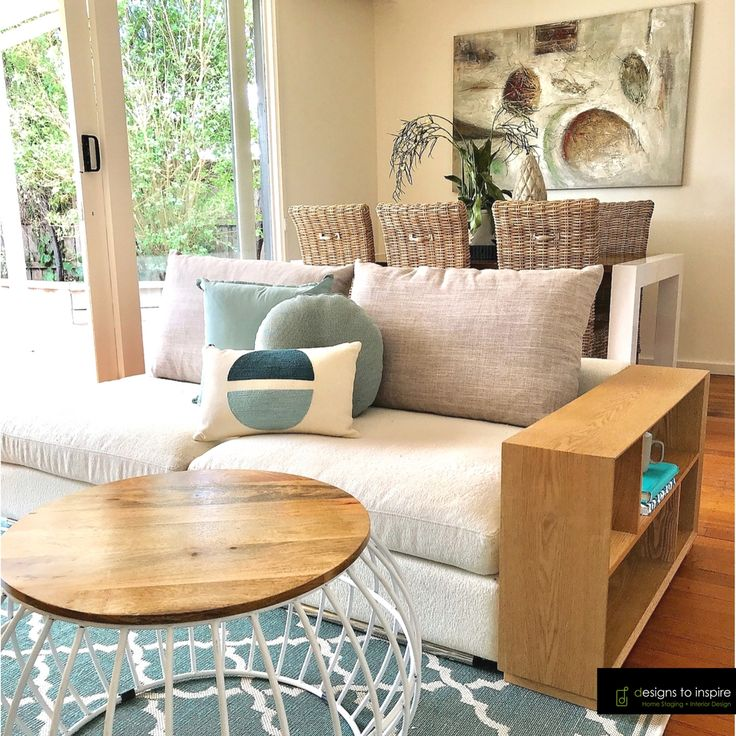 Elements of coastal style - wicker chairs, light timber and a colour palette or seafoam and neutrals! We're ready for our beach side escape #designstoinspire #homestyle