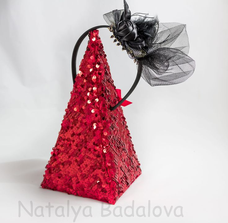 A personal favourite from my Etsy shop https://www.etsy.com/ie/listing/571835681/black-hairband-veil-feathers-hat-flower