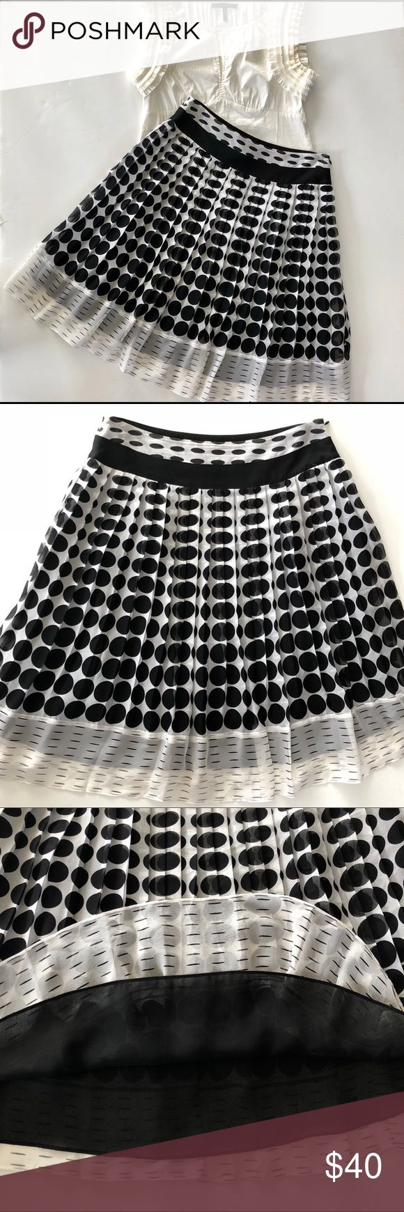 "Alfani Silk Polka Dot Skirt Gorgeous pleated silk twirling skirt with polka dot pattern and dashed hem.  It has a 100% Polyester Black underlay.  There is a hidden side zipper with hook & eye.  It's ivory/ black and looks stunning on. Size 8 Petite.  Approx Measurements 15"" waist and 24"" length Alfani Skirts Midi"