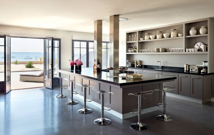 Lovely kitchen that opens to the patio. Huge island. I would have more white cabinetry and the open shelving, but only with some closed cabinetry too. Smallbone of Devizes.