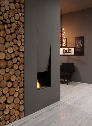 This would be so cozy for a den. I adore the wall of logs on the left, probably would only use it for decoration though, as apparently my city doesn't allow wood burning fireplaces anymore.