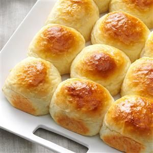 """Hawaiian Dinner Rolls Recipe -""""Pineapple and coconut give a subtle sweetness to these golden rolls,"""" writes Kathy Kurtz of Glendora, Florida. """"If there are any leftovers, they're great for sandwiches."""""""