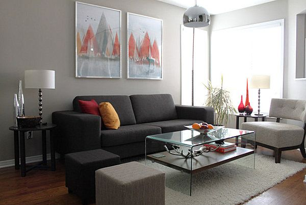 In yet another gray space, vibrant red and orange accents pop against neutral walls and furnishings. [from Leclair Decor + Design via Houzz]
