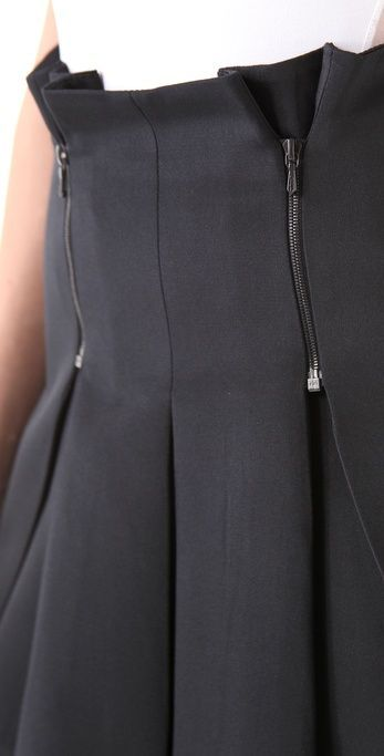 Black skirt with inverted box pleats and zippers at waist.. DIY the look yourself: http://mjtrends.com/pins.php?name=zippers-for-pleated-skirt