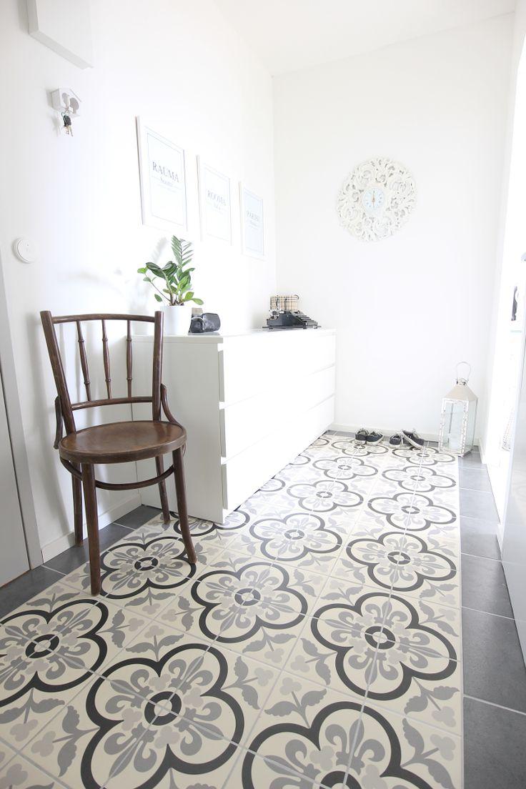 New pics from our entry.  I love those floor tiles! Koti-ikävä blog.