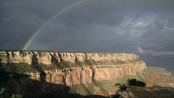 As we start our guided OARS hike down the South Kaibab Trail, a rainbow that begins on the South Rim seems to point the way to where we will finish at the base of the Grand Canyon.