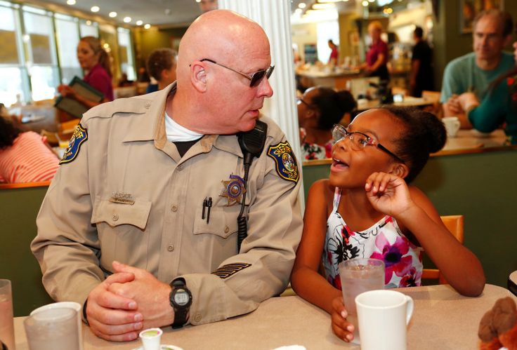 'Uncle Rick' for Life - Santa Clara County Sheriff Deputy, Rick Chaeff, reunites with Isys Robinson, 7, and her family at the Goodies Cafe in Campbell, California, on Friday, July 21, 2017. Seven years ago, Deputy Chaeff saved Isys' life in front of Goodies Cafe when she stopped breathing. She was only 17-days-old at the time. The family has kept in touch over the years.  (Gary Reyes/ Bay Area News Group)