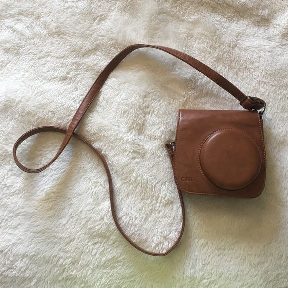 Polaroid camera case Brown, faux leather and suede, vintage, instax instant camera case. Adjustable strap and removable top. Super cute and convenient. Urban Outfitters Bags Cosmetic Bags & Cases