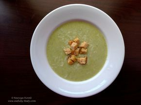 Supa crema de dovlecel.  Courgette cream soup served with grated parmesan cheese and croutons.