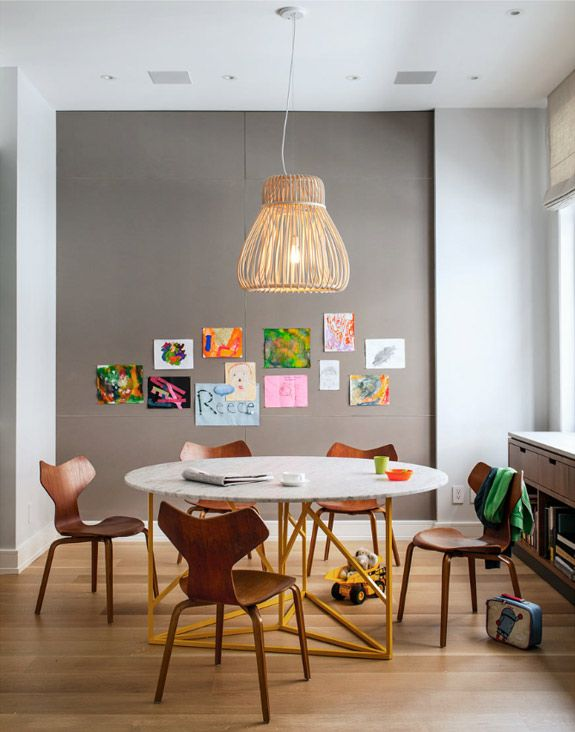 Perfect kid friendly dinning room, will have to try this art display for our living room when the wee one is older :)