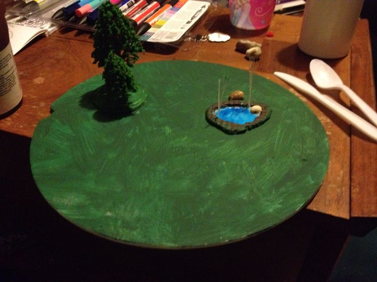 Forest and pool terrain piece, work in progress(made using polystyrene pizza packaging and ready made trees, shells, stones and brush bristles).