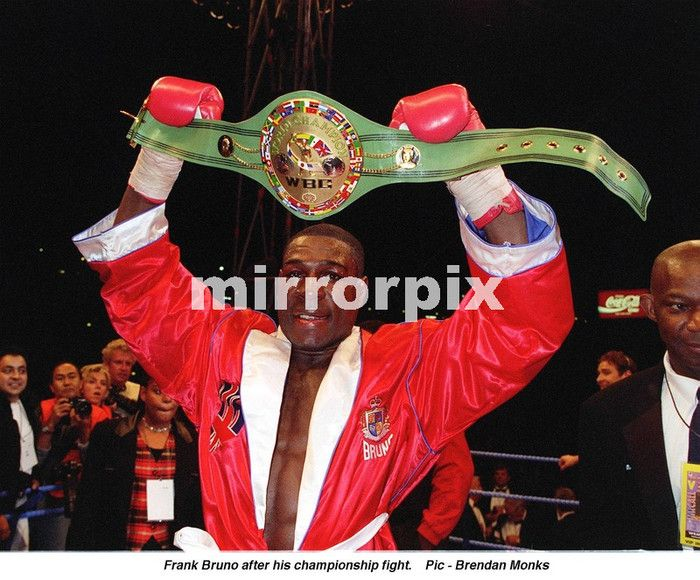 Frank Bruno hold aloft his WBC World Boxing Council Championship belt after defeating Oliver McCall over 12 rounds at Wembley Stadium