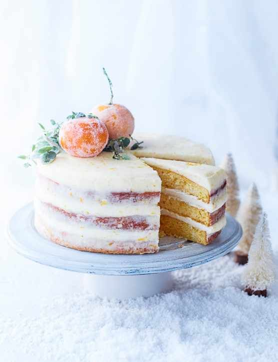 Clementine yoghurt cake with whole sugared clementines and thyme on top