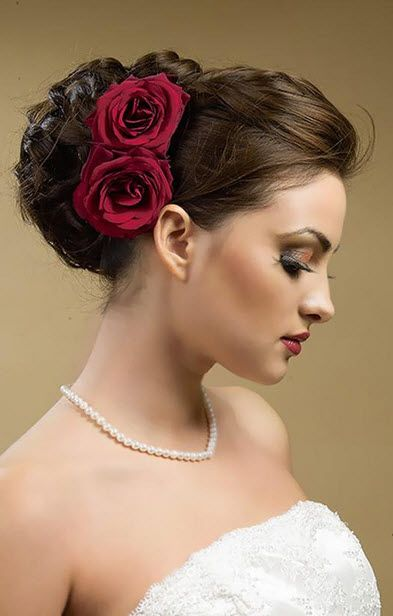 Beautiful Wedding Updo Bun Hairstyles with Rose Flower for Long Hair in Dark Brown Color in Side View