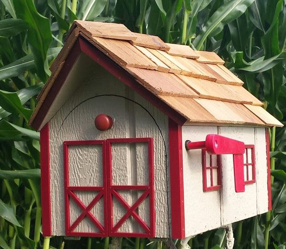 This Traditional Dutch Barn Mailbox is sure go get many compliments. Available in several colors, there should be one to match your style. The wooden material this is made of along with a good exterior paint will give a long time of mail service. Our roof is made with cedar shakes. **Our mailboxes now have a cedar shake ridge cap in place of the treated wood strip. We like the look. The Amish craftsmen partner takes great pride in his work. The approximate dimensions: 22.5 x 14 x 13  Choose…