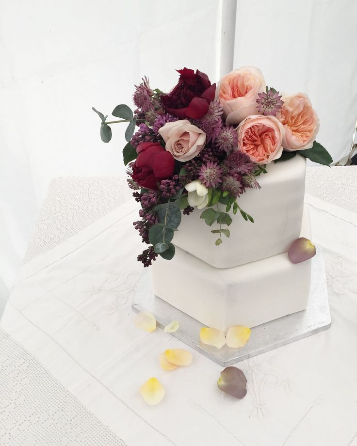 Two hexagonal tiers | rich nutty tamarind fruit cake on the base, almond rhubarb and orange blossom on the top. Hexagonal wedding cake by Lucy Burton