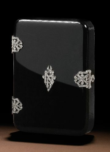 AN ART DECO JEWELLED ONYX CIGARETTE CASE, MAKER'S MARK LB A TANKARD BETWEEN IN A HORIZONTAL LOZENGE, FRANCE, CIRCA 1930.