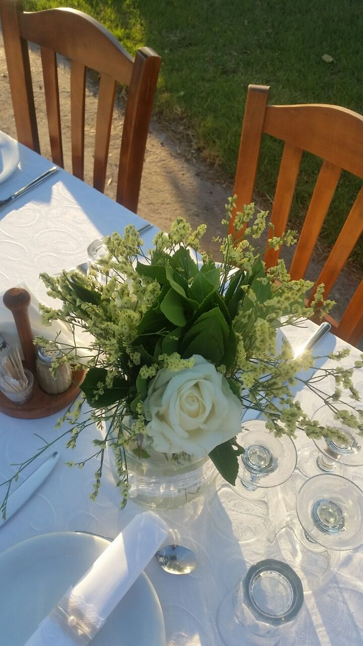 Wildflower wedding table vases decoration with white roses and eucalyptus by Gourioti Flowers