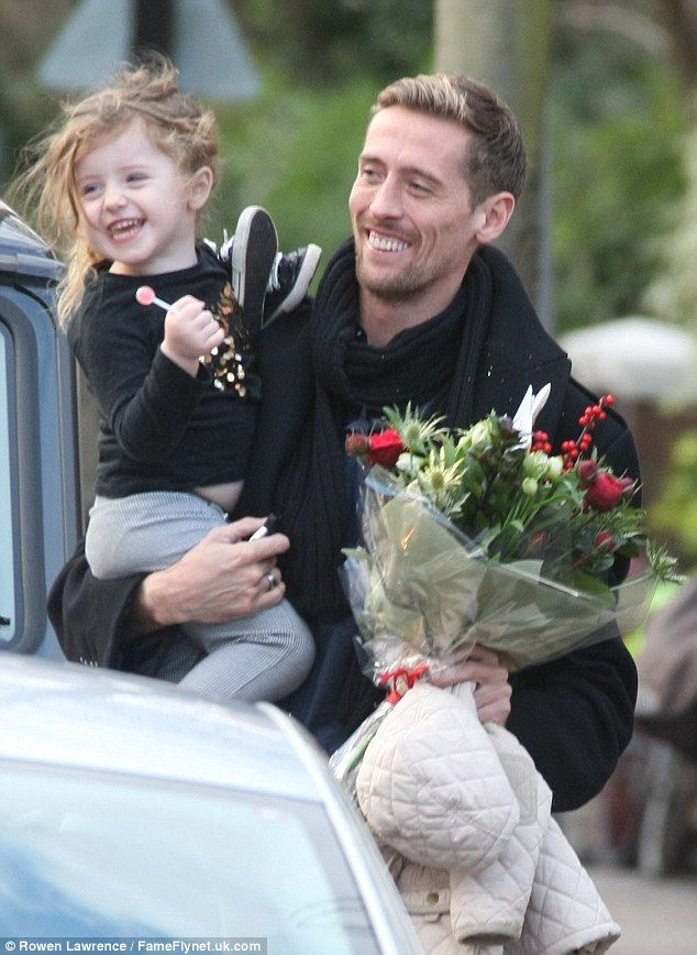 Footballer Peter Crouch arrives home with Daughter Sophia and a bouquet for wife Abbey Clancy