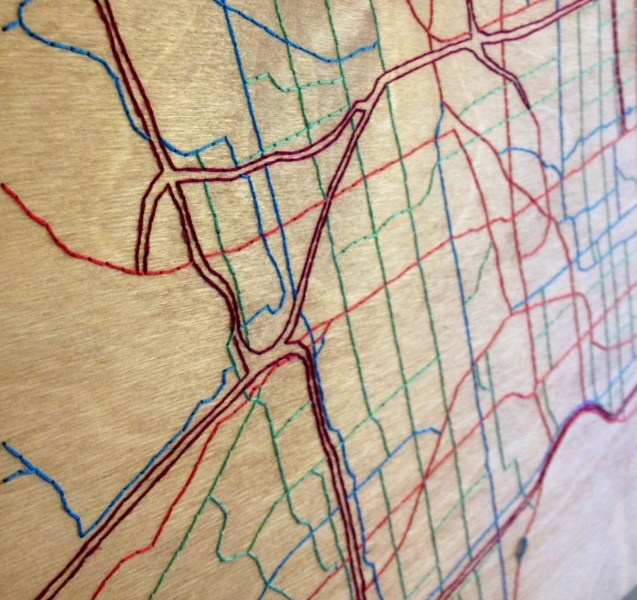 Close up, embroidered wood street map, Toronto