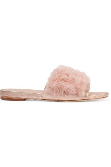Fuzzy footwear is a key trend this season and we love Loeffler Randall's playful take. These slides are made from rose gold leather and topped with soft pastel-pink shearling. Let yours peek out from jeans or wide-leg pants.