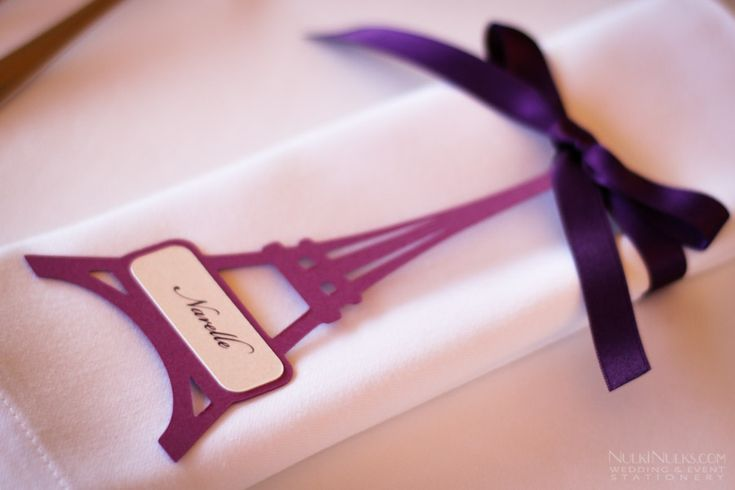 Place card and decorated napkin  http://www.nulkinulks.com/blog/real-weddings/paris-theme-wedding-tale/
