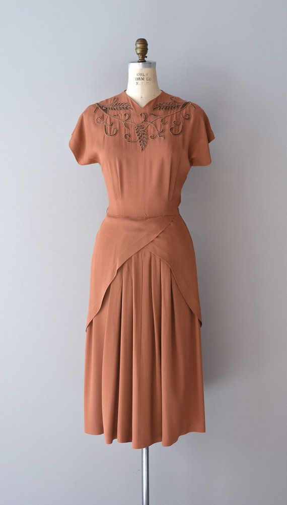 1940s rayon dress. Beautiful neckline.. the hip-business would be a disastrous look for my larger hips.