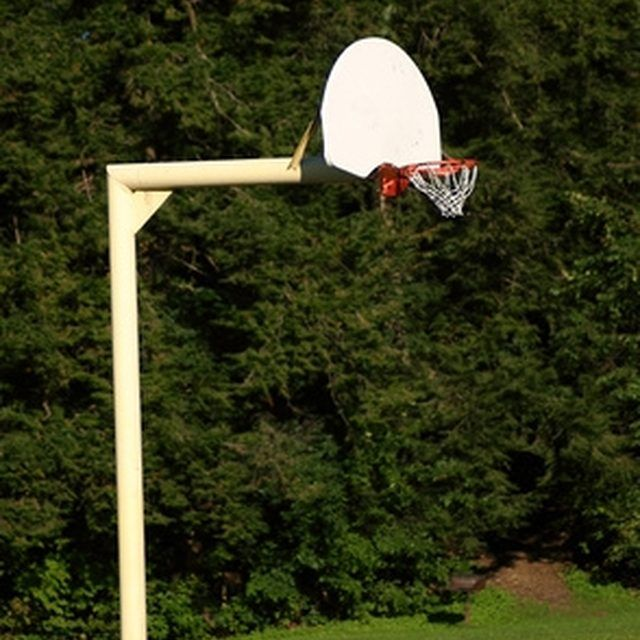 A portable basketball goal can be converted to an in-ground setup.