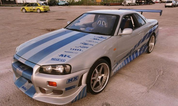 "The 1999 Nissan Skyline R34 GT-R is a major car driven by Brian O'Conner in 2 Fast 2 Furious. After having his Mitsubishi 3000GT impounded by officers in Dallas, Texas, Brian gets a ride from ""The Girl"" to a used car dealership, where he spots the Skyline. Brian purchases the car in cash with his previous winnings and drives it away. He later gives it a paint job, and works underneath the car in a garage."
