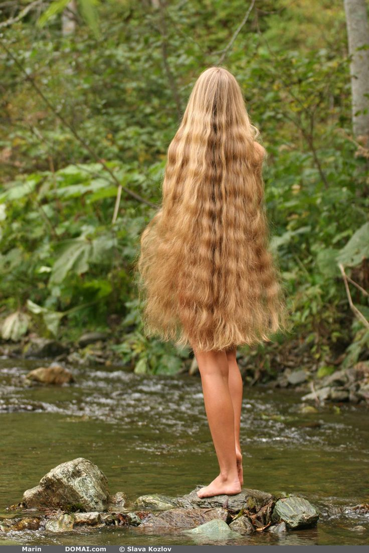 Model with long, wavy hair. -- Actually, it's wavy from having been in a braid... Which I think most women with hair this long have most of the time!